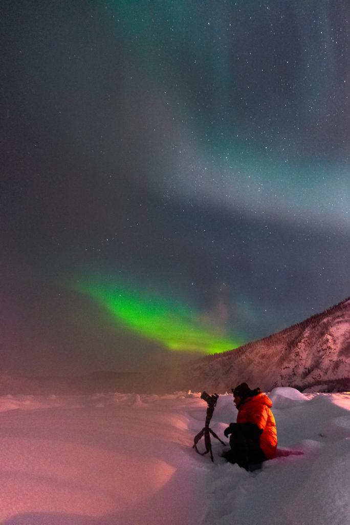 Brenda Petrella Photographing the Northern Lights on the Yukon River in Dawson, Yukon Territory, Canada